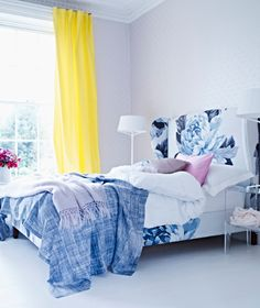 love the indigo hand dyed fabric look with the upholstered bed. Idea for creating dip dyed pillow covers from Ikea