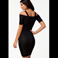 Tight black dress Cute tight black dress. Faux leather. Knit in front. Worn 1 time. Dresses