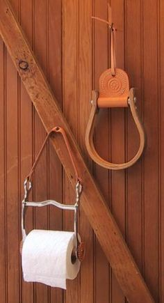 Horse bit toilet paper holder and stirrup towel holder.  Love it only want used stuff, not all shiny new looking....kinda takes away from the rustic look