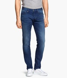 &DENIM. 5-pocket, low-rise jeans in washed denim with slim legs, distressed details, and a button fly.