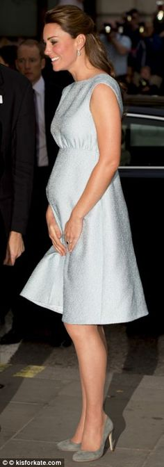 28 weeks: April 24 - The Duchess continued a busy week with an evening visit to the Art Room at the National Portrait Gallery wearing a flattering Fifties-style Emilia Wickstead frock, £1,450, with Rupert Sanderson grey suede pumps, £450, and Kiki McDonough diamond and green amethyst earrings, £1,900
