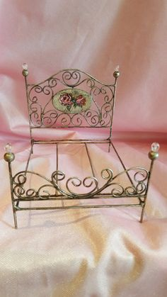 Almudena Moreno, ArtLittle - welded bed with hand painted wooden medallion