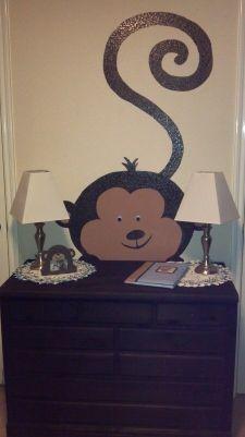 Monkey peeking behind dresser. Monkey nursery.