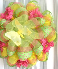 I'm soooo going to start adding more ribbon to my wreaths...love this for spring!