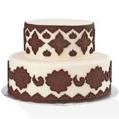 Create amazing detail quickly with our Global Designs Fondant & Gum Paste Mold. Give a regal look to this majestic-tiered cake with elegant shapes lie the triangle border, 4-petal flower, global flower, scallop border, crown, scallop paisley, small and large global leaf.