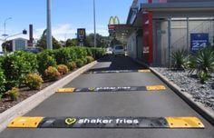 Creative Ad for shaker fries for Mc Donalds on the speedbumps.      Creatieve advertentie van McDonalds voor 'shaker fries' op de verkeersdrempels.