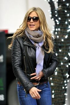 Pair a leather jacket with a bundled scarf for cute + practical winter outfits