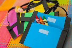 Mini crayon wallet- punch small holes on sides & let kids sew ribbon or pipe cleaners through instead of duct tape.