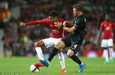 Jesse Lingard (left) battles with Igor Chaykovsky as the Warrington-born winger looks to g...