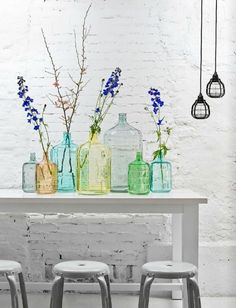 Pretty display: Wide glass jugs with small throats are perfect for arranging tall branches or blooms