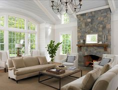 Love the windows by the fireplace and the stone work running up /down on the mantel