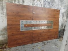 Hinged Brown Stainless Steel And Wooden Gate, Thickness: Material Grade: Rs 1200 /square feet Modern Main Gate Designs, Iron Main Gate Design, Home Gate Design, House Main Gates Design, Steel Gate Design, Front Gate Design, Main Door Design, Design Your Dream House, Modern Entrance Door