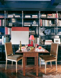Miles Redd designed the ebonized wood and sterling bookshelf, where a colorblock painting by Leora Armstrong hangs.