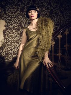 Essie Davis as the Hon. Phryne Fisher. The show has absolutely wonderful costumes and she's amazing *.*