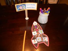 Toy Story- Buzz's Rocket Repair Shop. They colored Rockets, I put a small square piece of paper on the back with tape on 3 sides leaving the bottom open, insert straw, blow, rocket flies.