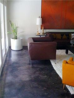 This residential concrete, previously carpeted, was stained with Kemiko 'Black'. The final color is a marbled mix of black, gray-tones and dark walnut, finished with a clear sealer and acrylic topcoat. Painted Concrete Floors, Painting Concrete, Stained Concrete, Basement Flooring, Kitchen Flooring, Concrete Coatings, Concrete Driveways, Floor Stain, Black Floor
