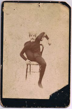 "Late Victorian portrait of a male circus performer wearing a headpiece and mustache contorting his body.   The reverse has a dedication in black ink, ""From Edward to Br. Arthur 1896""."