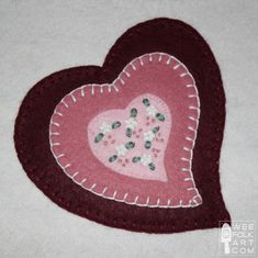Felt heart applique block pattern for Brianna and Ruby.  We'll skip the embroidery in the middle at this stage.