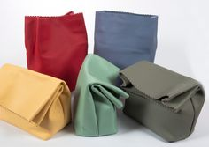 one of our best sellers! super market small clutch!handmade leather bag! choose the one you prefer! shop online at www.rien.gr