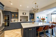 We are lucky at Herringbone Kitchens to have clients with amazing style. This bespoke kitchen extension in Surrey is hand painted in Mylands Bond Street and finished with brass handles from Armac Martin. We have had so much fun working on this project and Open Plan Kitchen Diner, Open Plan Kitchen Dining, Living Room Kitchen, Kitchen Diner, Open Plan Kitchen Living Room, Open Plan Kitchen Dining Living, Kitchen Diner Extension, Home Decor Kitchen, Kitchen Interior