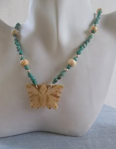 Bone Butterfly and Turquoise Necklace by ShadowoftheCross on Etsy
