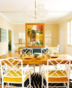 Mirrored dining room with natural grass cloth walls.. fabulous! Painting & console on mirror wall.