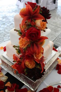 wedding cake adorned with exotic flowers