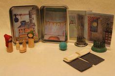 Tiny tin take along doll house