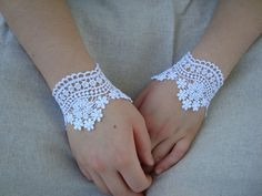 Sweet lace wrist wraps.