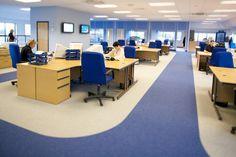 Open plan office space blue floor.