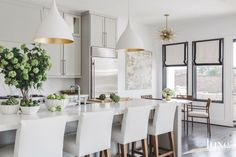 Soft Gray Kitchen with AERIN Pendants and Statuary Marble Counters and Backsplash | Interiors by Paloma Contreras | Luxe Magazine March/April 2017