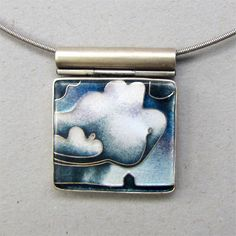 Storm Cloud     Cloisonne enamel on fine silver, set in sterling.   One inch by 15/16 inch cloisonne enamel with a 16 inch tension clasp neckwire.