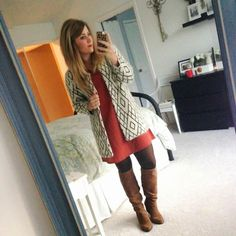 rusty orange dress under a geometric print coat. brown boots and tights