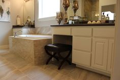 Master bath with white cabinets and sand colored neutral tile flooring and oval tiles on the soaking tub. Cabinet doors by TaylorCraft Cabinet Door Company Laundry In Bathroom, Master Bathroom, Painted Doors, Custom Cabinets, Bathroom Cabinets, White Cabinets, Cabinet Doors, Corner Bathtub, Central Texas