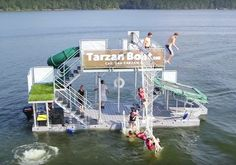 The Tarzan Boat is a boat with a bunch of jumping platforms and trampolines and rope swings and a slide attached.
