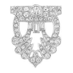 Art Deco Platinum and Diamond Brooch   One old European-cut diamond ap. .40 ct., 55 old-mine & single-cut & 3 baguette diamonds ap. 2.40 cts., c. 1925, white gold pin added later, ap. 6.5 dwt.
