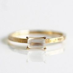 Simple, modern, rustic engagment ring.