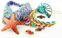 Medusa's new spring collection!!! Lots of brights in head bands and in our French starfish and shell barrettes!