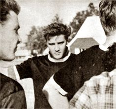 Elvis playing touch football in Memphis with friends in summer 1960.