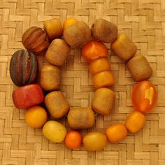 Vintage Amber, 25 Beads from Tibet Nepal, via Etsy.