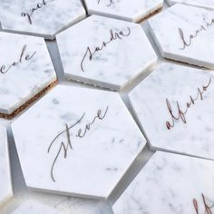 calligraphy on marble coasters for place cards as well as souvenirs :)