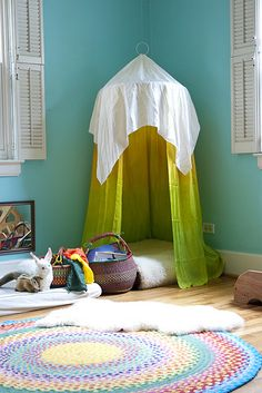 Beautiful Reading Canopy by sewliberated: Made by sewing silk onto a circular hand quilting hoop which was suspended with hemp twine to a sling ring and then hung from a ceiling hook with fishing wire. Another square of white silk was draped over the top. #Reading_Canopy #Play_Tent #sewliberated