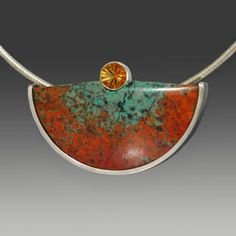 """Wolfgang Vaatz: , Pendant/brooch in cuprite and chrysocolla from Sonora Mexico, 8mm golden citrine, and partially oxidized sterling silver. Pendant only. Neckwire sold separately. 1.33 x 2.12 x 0.38""""."""