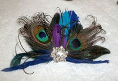 Check out this item in my Etsy shop https://www.etsy.com/listing/126793762/wedding-fascinator-wedding-hair-clip
