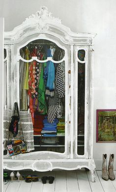 whitewashed armoire with bright lovely clothes. sigh.