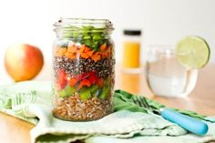 7 Layer Salad in a Jar is the Perfect Portable Lunch |  Layers of whole grains (wheatberries and quinoa) are mixed with a variety of vegetables including carrots, edamame, and red and green bell pepper.  A light and refreshing oil-free orange and ginger dressing brings the whole salad together.  Seven layer salad in a jar is the perfect portable lunch for work or school. - Foodista.com