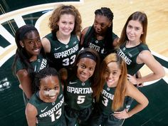 The new faces on the MSU women's basketball team are, left to right, (bottom row) Morgan Green, Octavia Barnes, Kalabrya Gondrezick, (top row), Victoria Gaines, Jenna Allen, Nathy Dambo and Hana Vesela Wednesday, Oct. 28, 2015, in East Lansing, Mich. Al Goldis, Al Goldis | For the Lansing State Journal