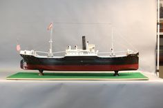 """Lot 228 - Large cargo ship model of the """"Cedar Spring"""". The tramp steamer is of Three Island Design with hatches, winches, ventilator funnels, wheel, portholes etc… 70"""" long x 11"""" wide x 32"""" high."""