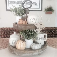 How to decorate a rustic tiered tray for fall with Rae Dunn pottery, pumpkins and greenery. How to decorate a rustic tiered tray for fall with Rae Dunn pottery, pumpkins and greenery. Farmhouse Style Kitchen, Modern Farmhouse Kitchens, Farmhouse Decor, Farmhouse Ideas, Fall Home Decor, Autumn Home, Diy Décoration, Tray Decor, Seasonal Decor