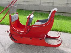 Vintage Antique metal glide sleigh turn of the century. Wooden frame with metal supports and glides. Four passenger single horse drawn.